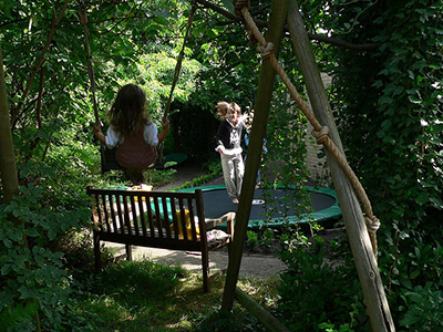 girls-on-trampoline-hidden-garden